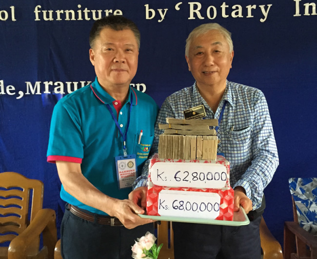 DonationsWaterFurniture - PDG Steve Yoshida and PP Moses donating to a school water tank and furniture.5