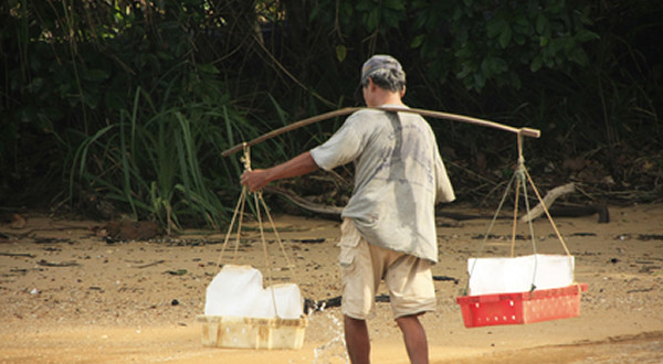 carrying water and ice to village